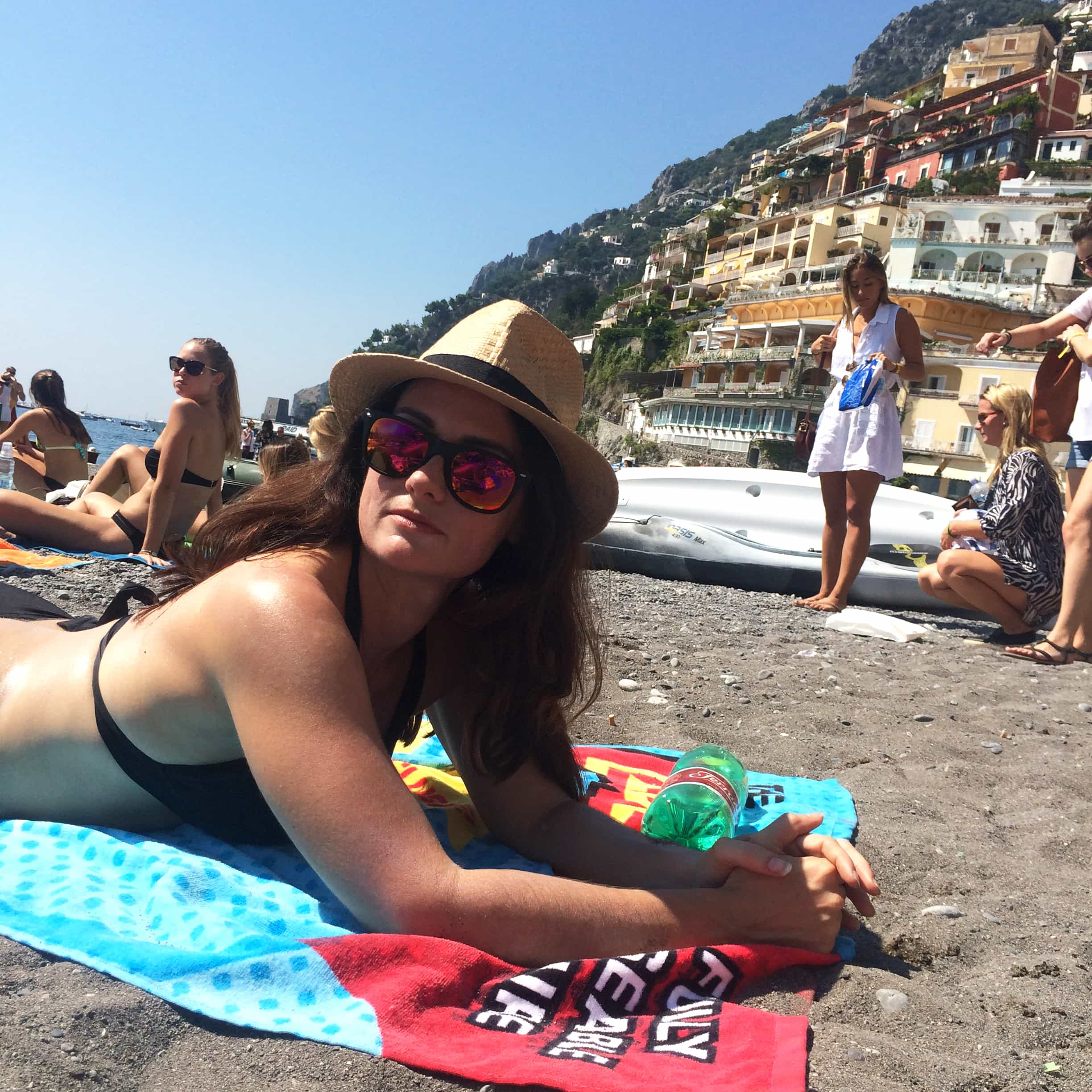 Me lounging on the black sand beach in Positano | LetsEatCake.com