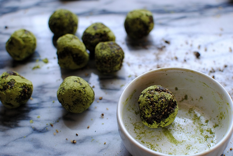 Chocolate Matcha Balls on a Marble Cutting Board