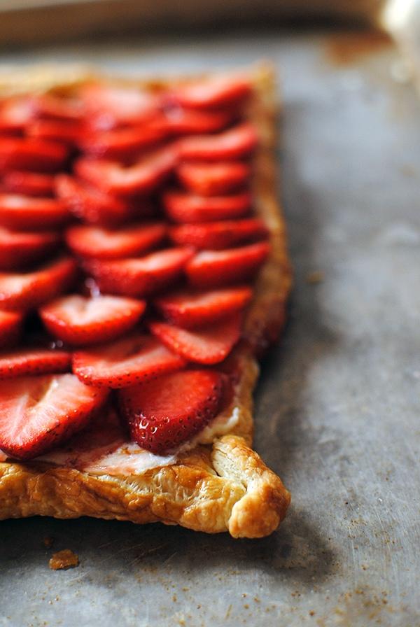Closeup of simple strawberry tart on baking sheet