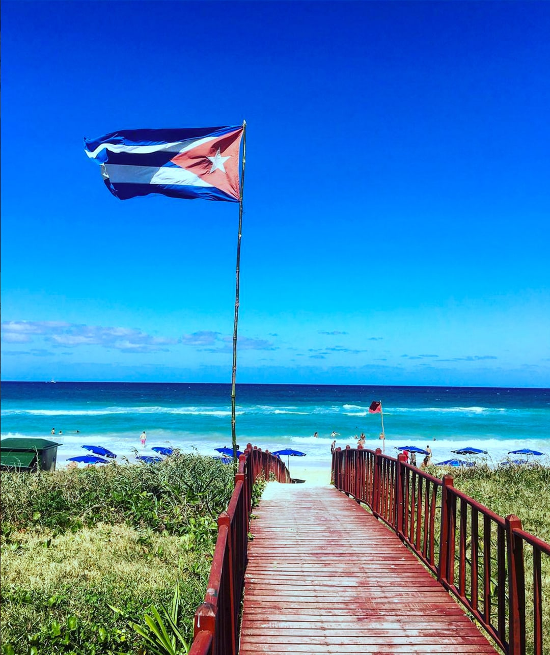 How to Travel to Cuba: Cuban Flag on Beach