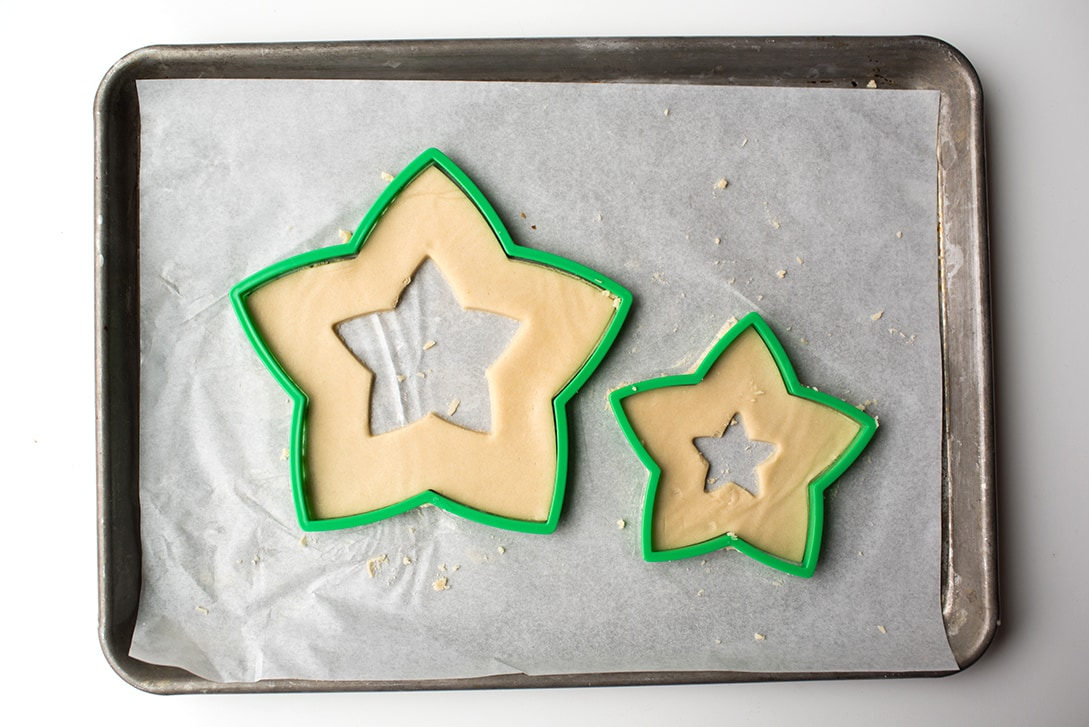 Cut out sugar cookie dough for star shaped cream tart cake