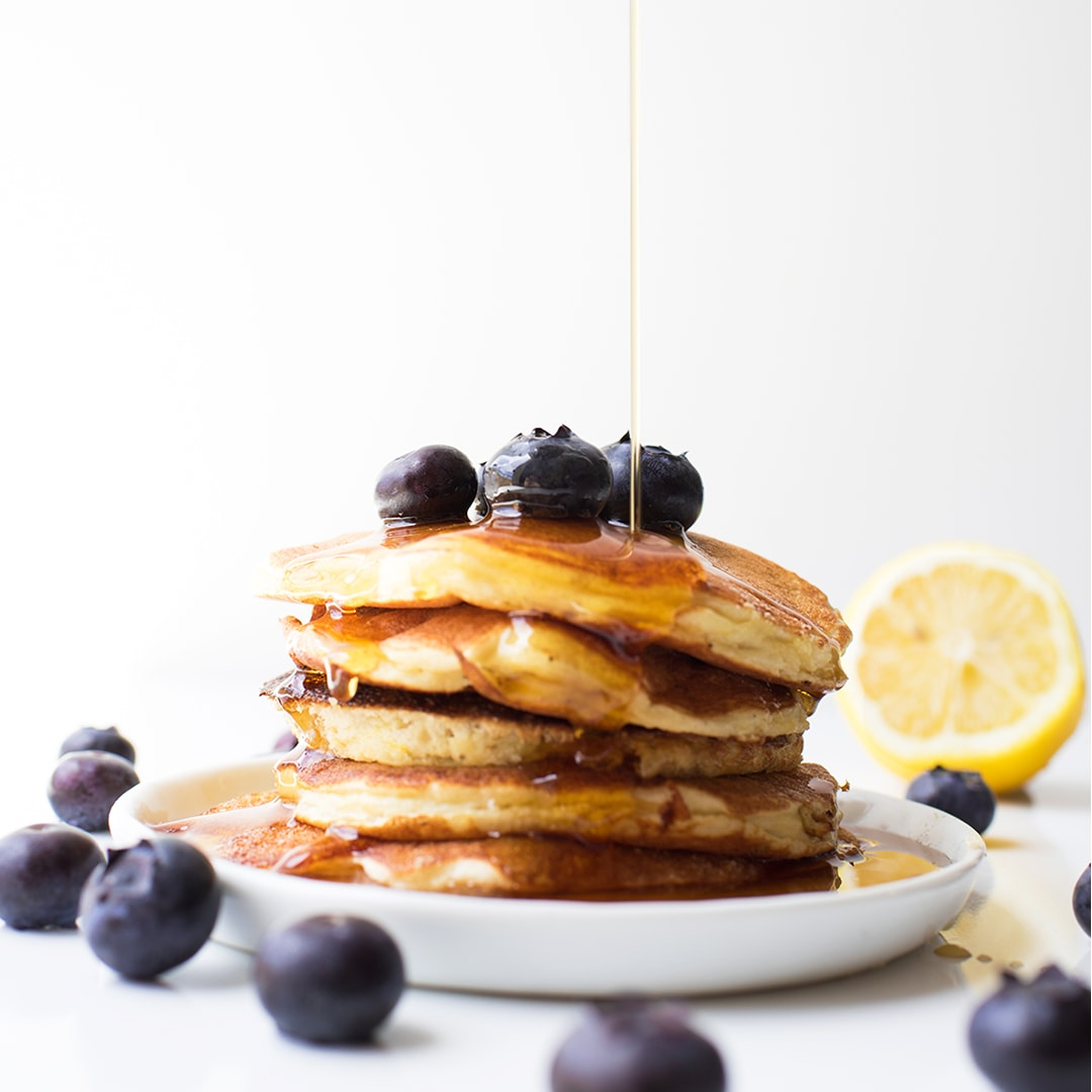 Easy Healthy Protein Pancakes on a white plate with syrup