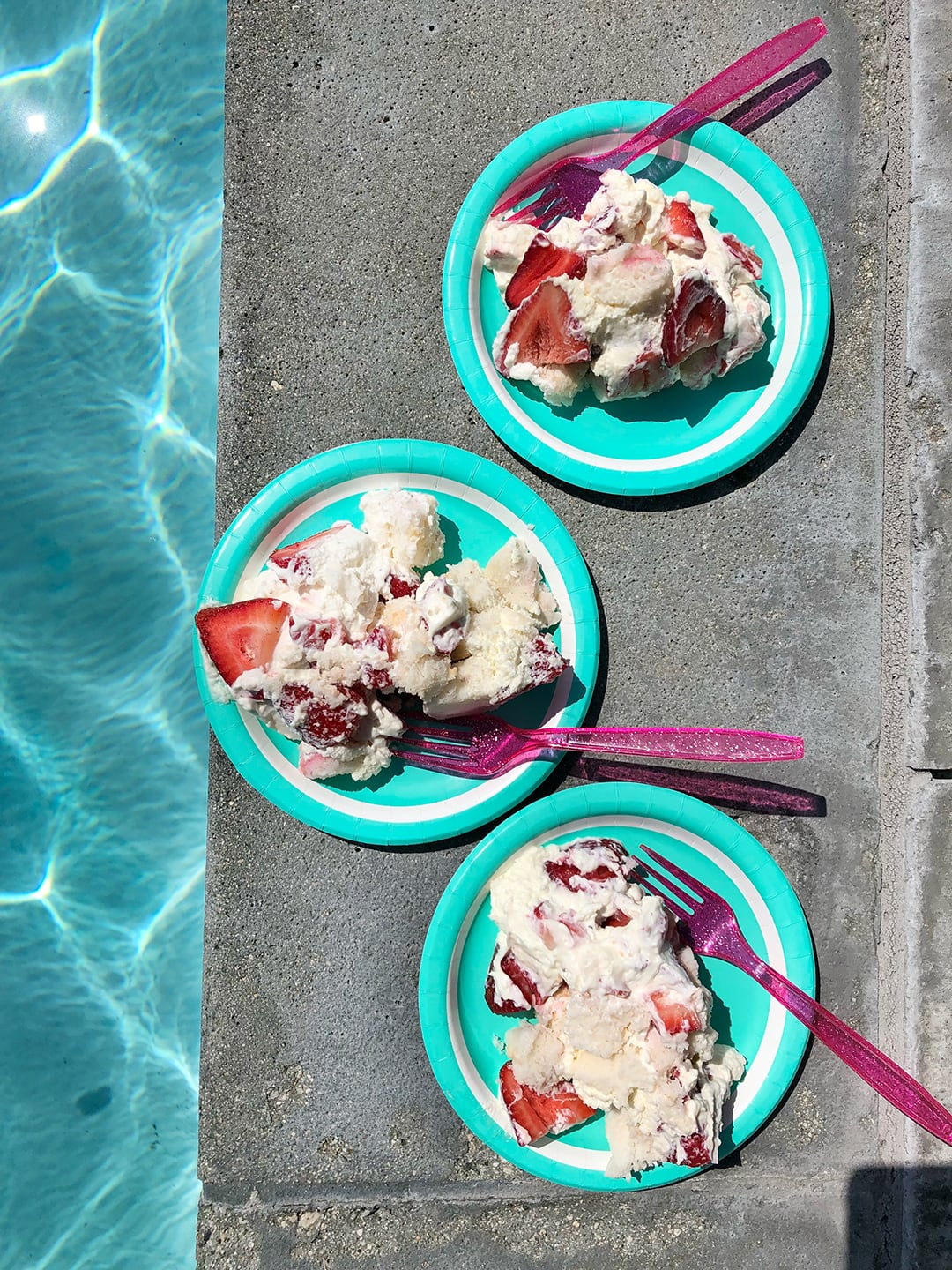 Strawberry Champagne Trifle slices near pool