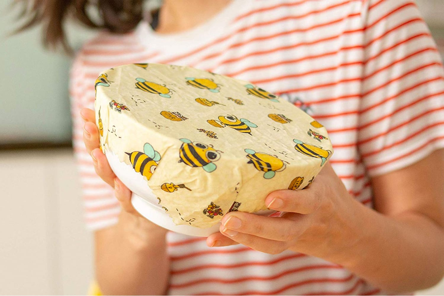 Beeswax Wrap - woman holding a bowl wrapped