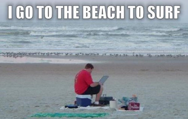 Beach Puns - Man on the Beach Surfing the Internet