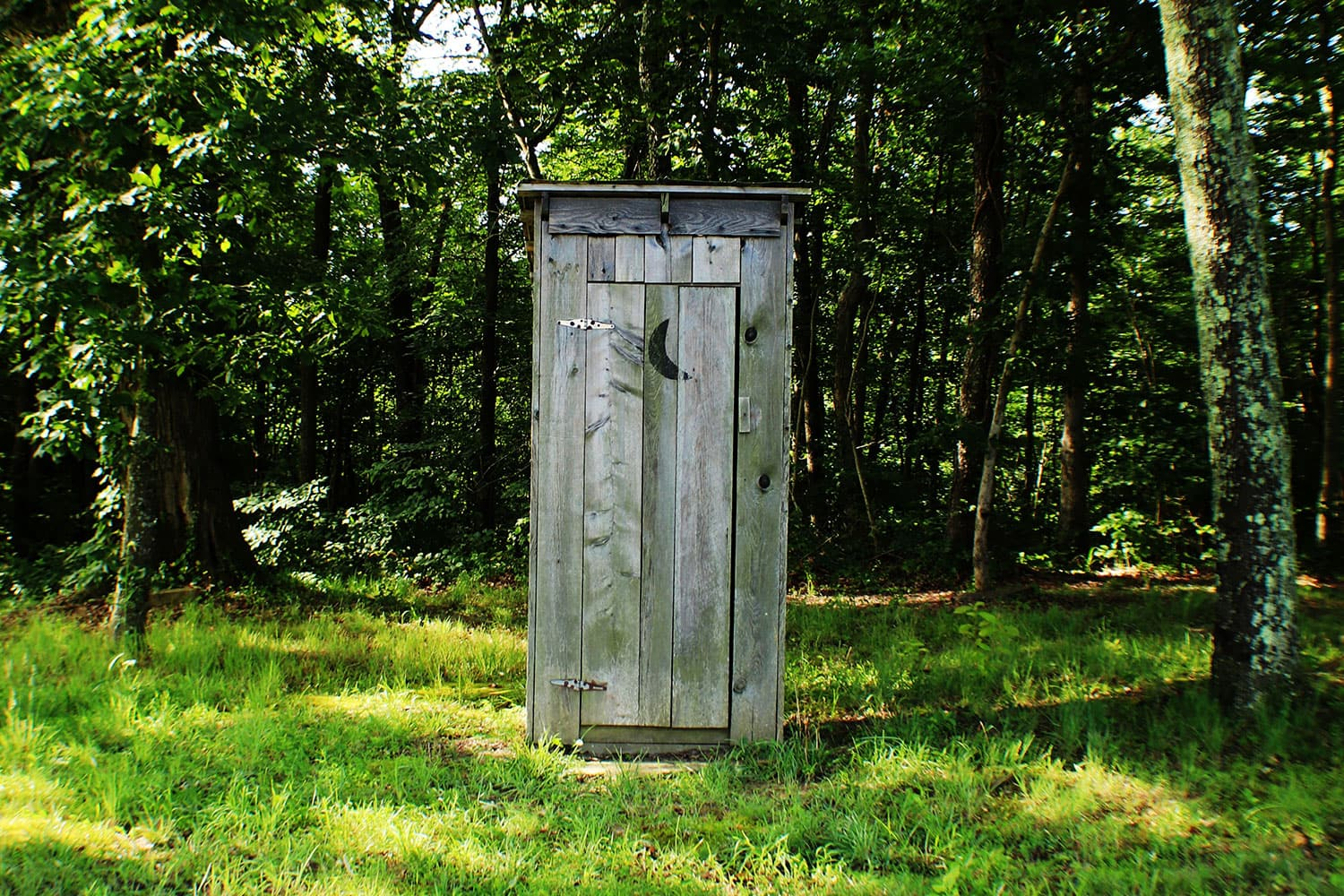 Types of Toilets Around the World - wooden outhouse