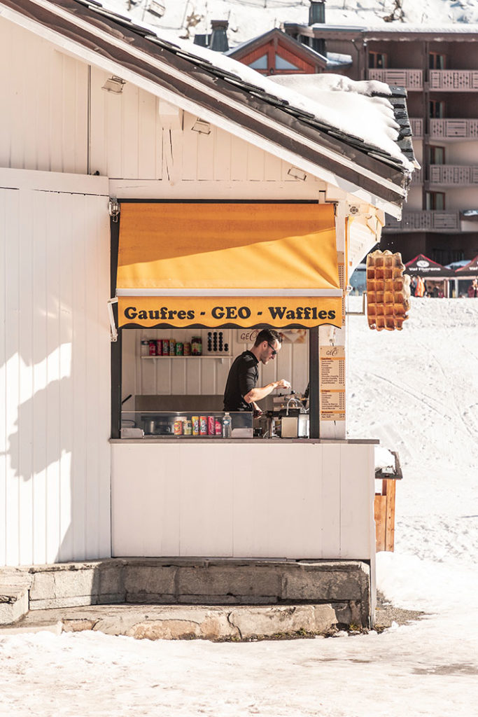 Where to Exchange Currency - man selling waffles