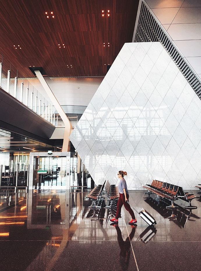 What Is TSA PreCheck - woman walking through airport