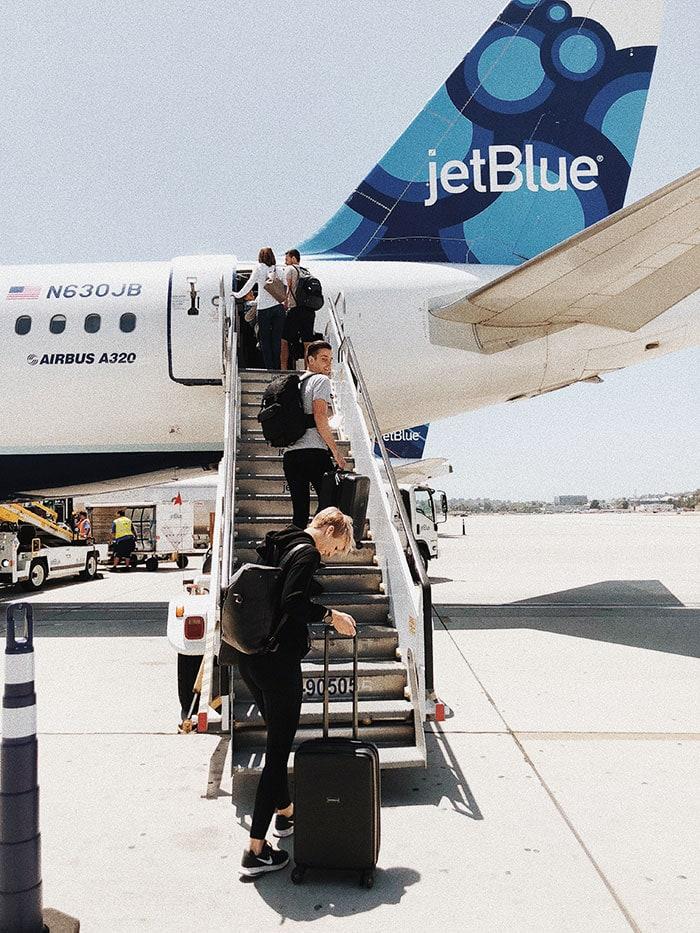 What Is TSA PreCheck - woman boarding plane on tarmac