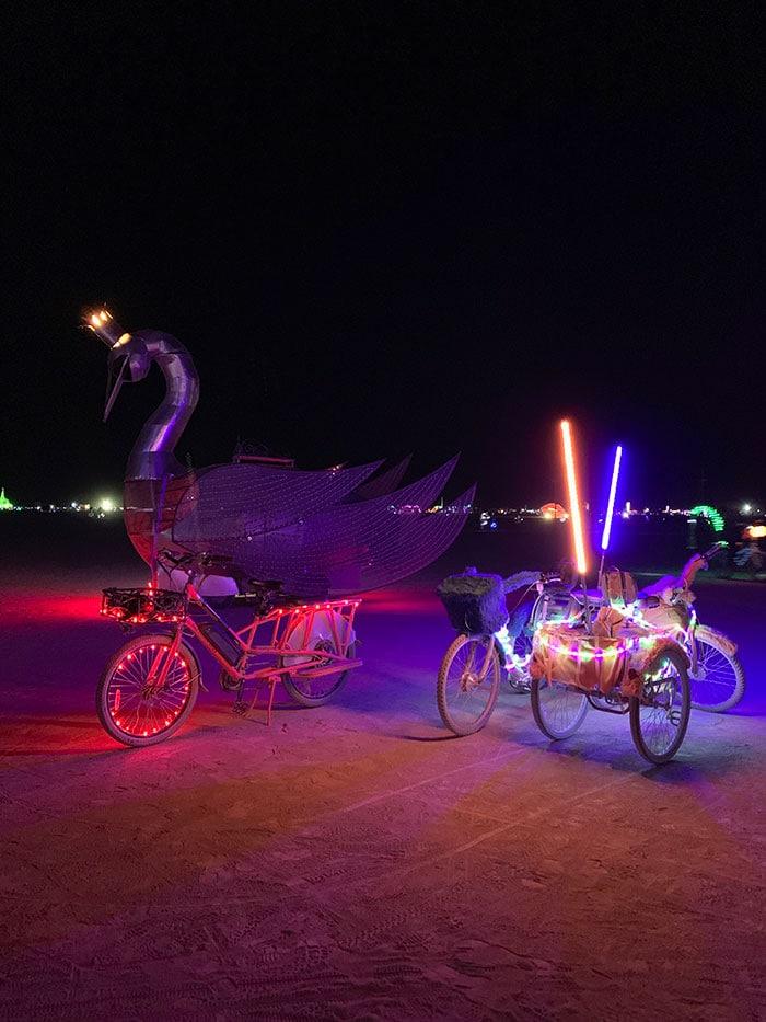10 Principles of Burning Man - neon bikes at night on the playa