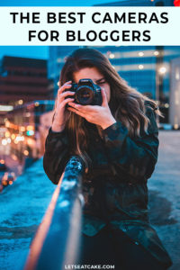 Best Camera for Blogging - woman holding canon