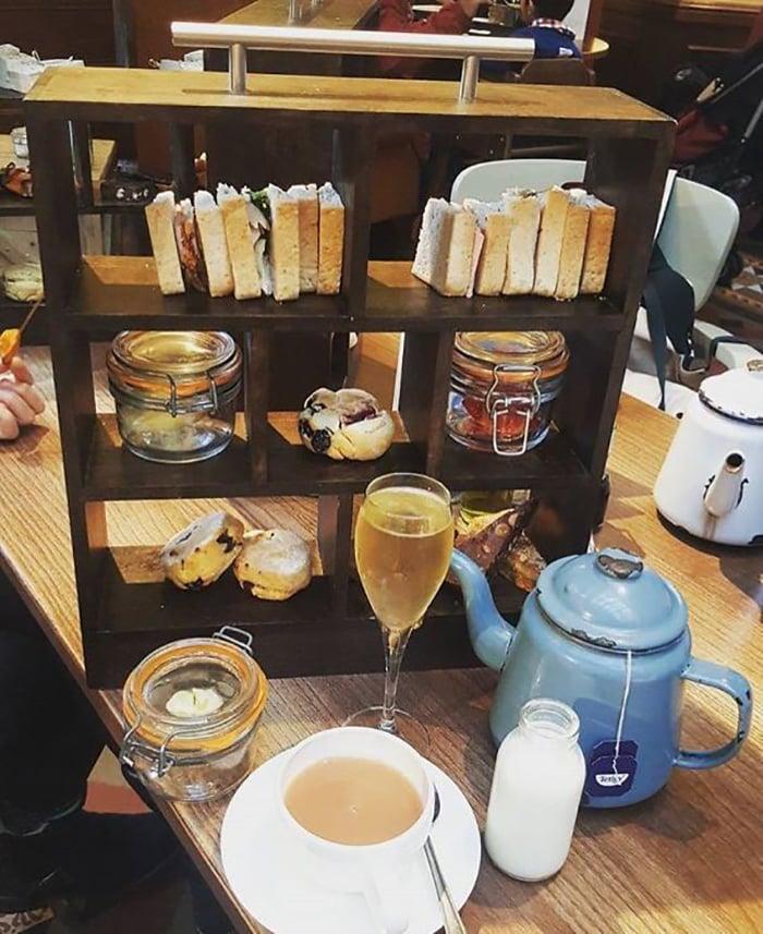 We Want Plates - sandwiches on bookshelf