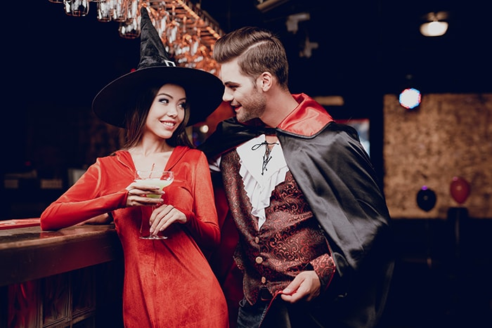 Halloween Jokes - Guy Dressed as Vampire Hitting on Woman Dressed as Witch at Party