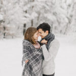 Christmas Captions for Instagram - Couple in Snowy Forest