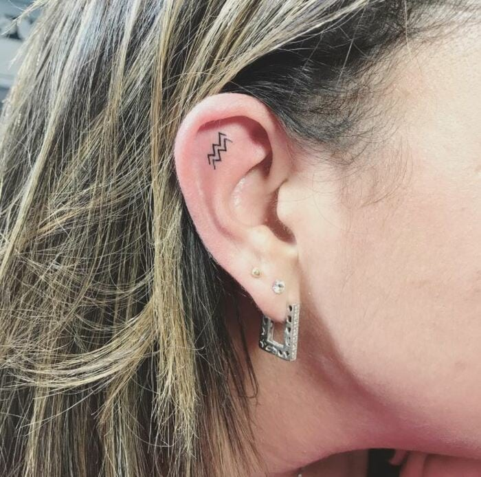 Aquarius Tattoos - Small delicate waves on ear