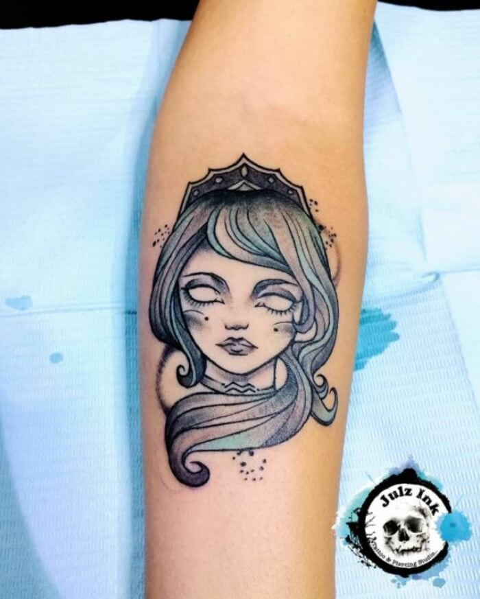 Aquarius Tattoos - black and blue water bearer face tattoo