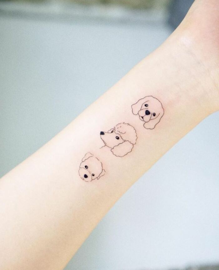 Minimalist Tattoos - Dog faces outline