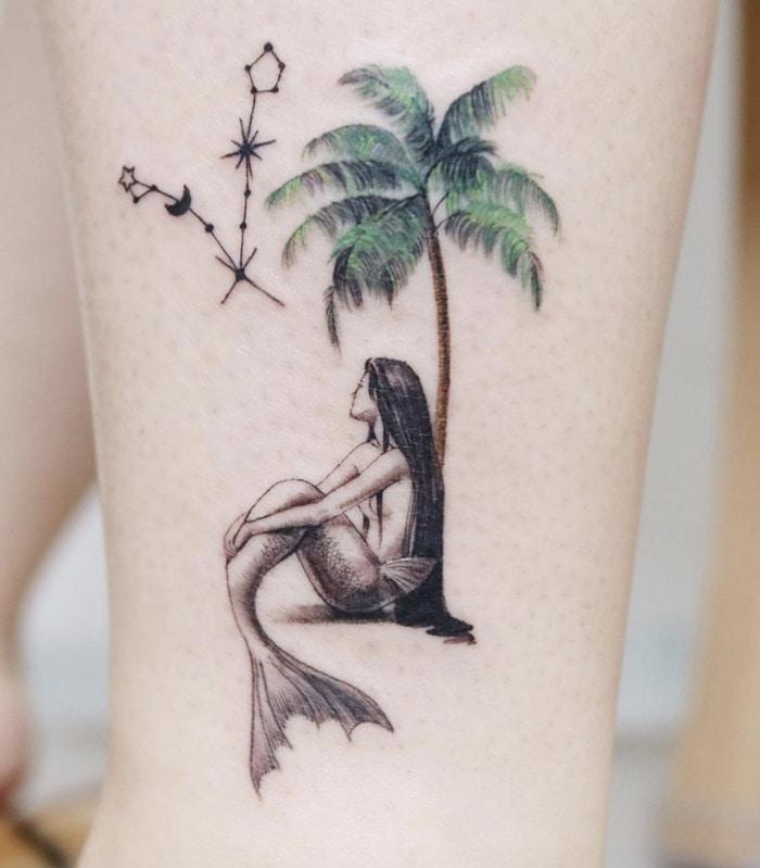 Pisces Tattoos - mermaid palm tree tattoo
