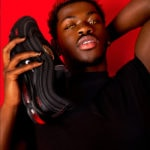 Lil Nas X holdingLil Nas X holding Satan Shoes Satan Shoe