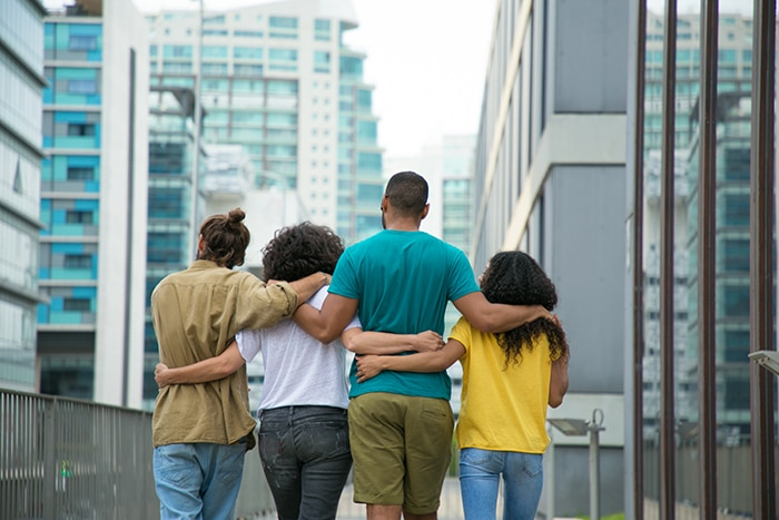 What Is Polyamory Types - Four people walking arm in arm