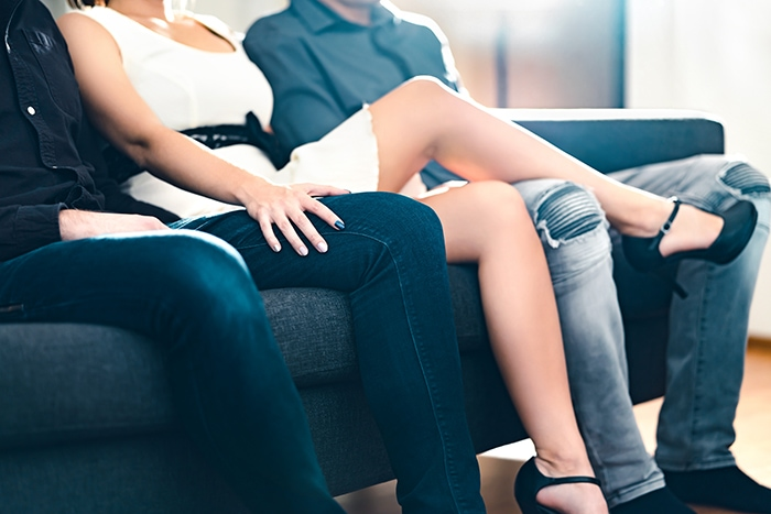 What Is Polyamory Types - woman and two men on couch