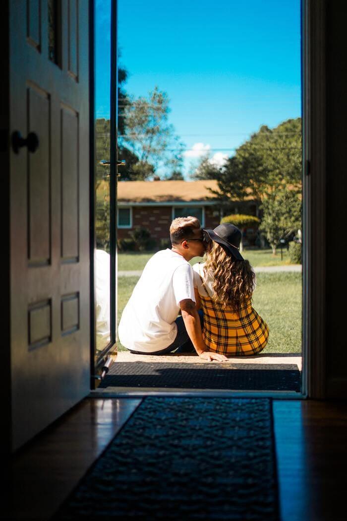 Polyamory Terms - Couple outside house