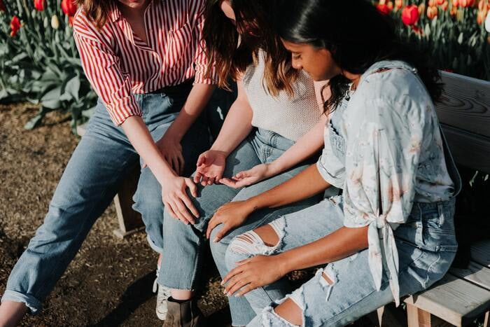 Polyamory Terms - three women holding hands