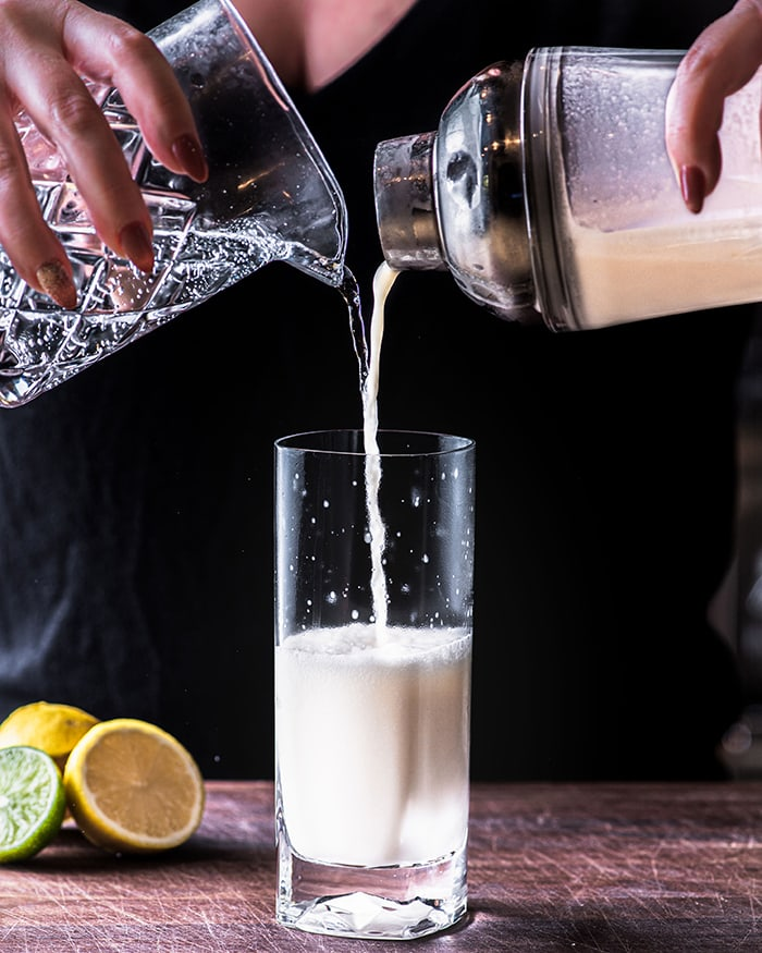 Ramos Gin Fizz - pouring from cocktail shaker