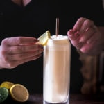 Ramos Gin Fizz - bartender placing lemon wedge