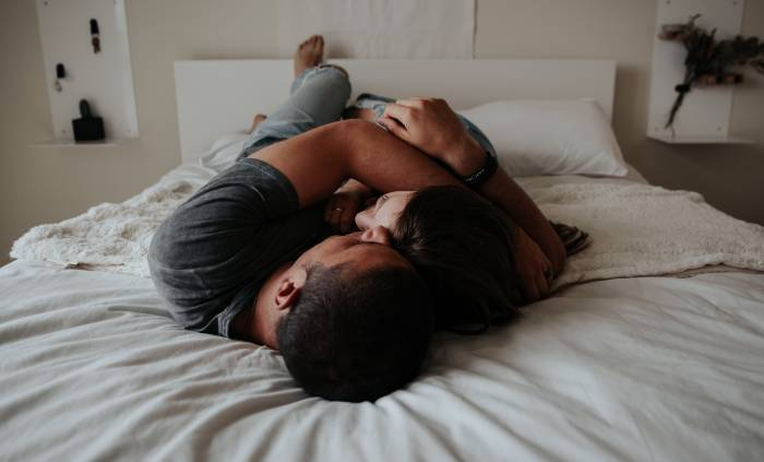 Signs a Man is Attracted to You Sexually - laying in bed