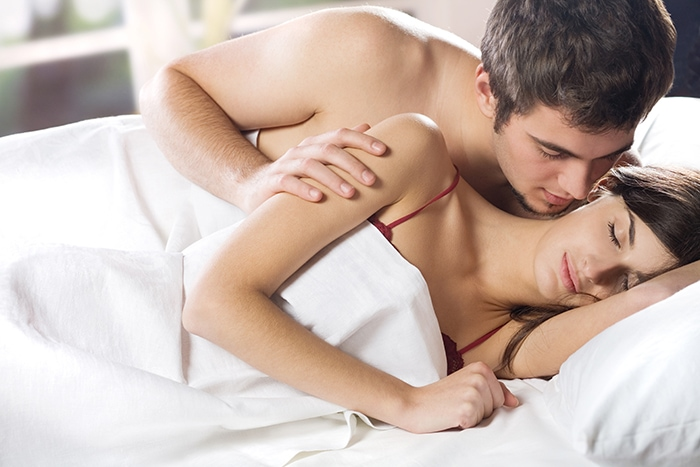 Dirty Talk - couple whispering in bed