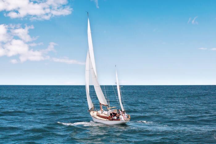 Corny Jokes - sailboat in water