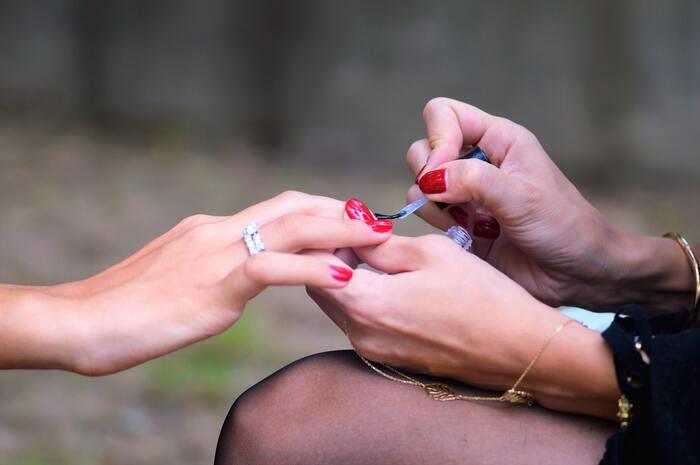 Dip Powder Nails - nail tech giving manicure