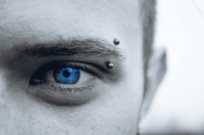 Eyebrow Piercing - close up blue eye